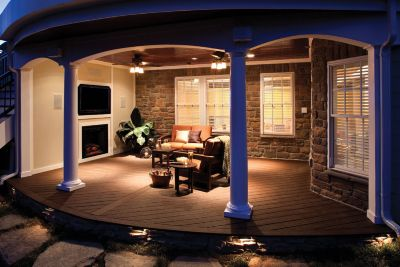 trex-contour-decking-honey-brown-night-shot Conrad Lumber Co